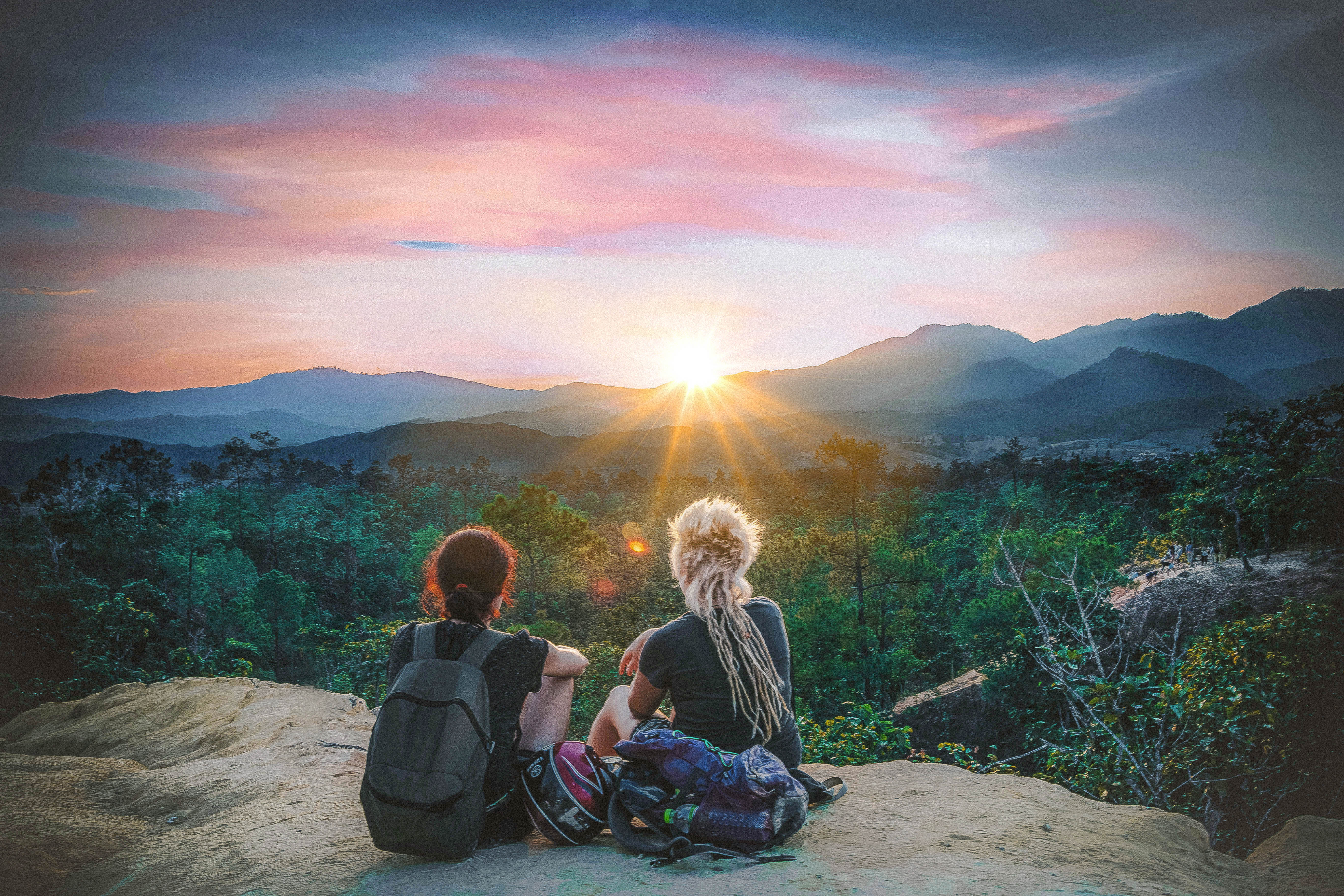 watching sunset in canyon in pai thailand hippie town