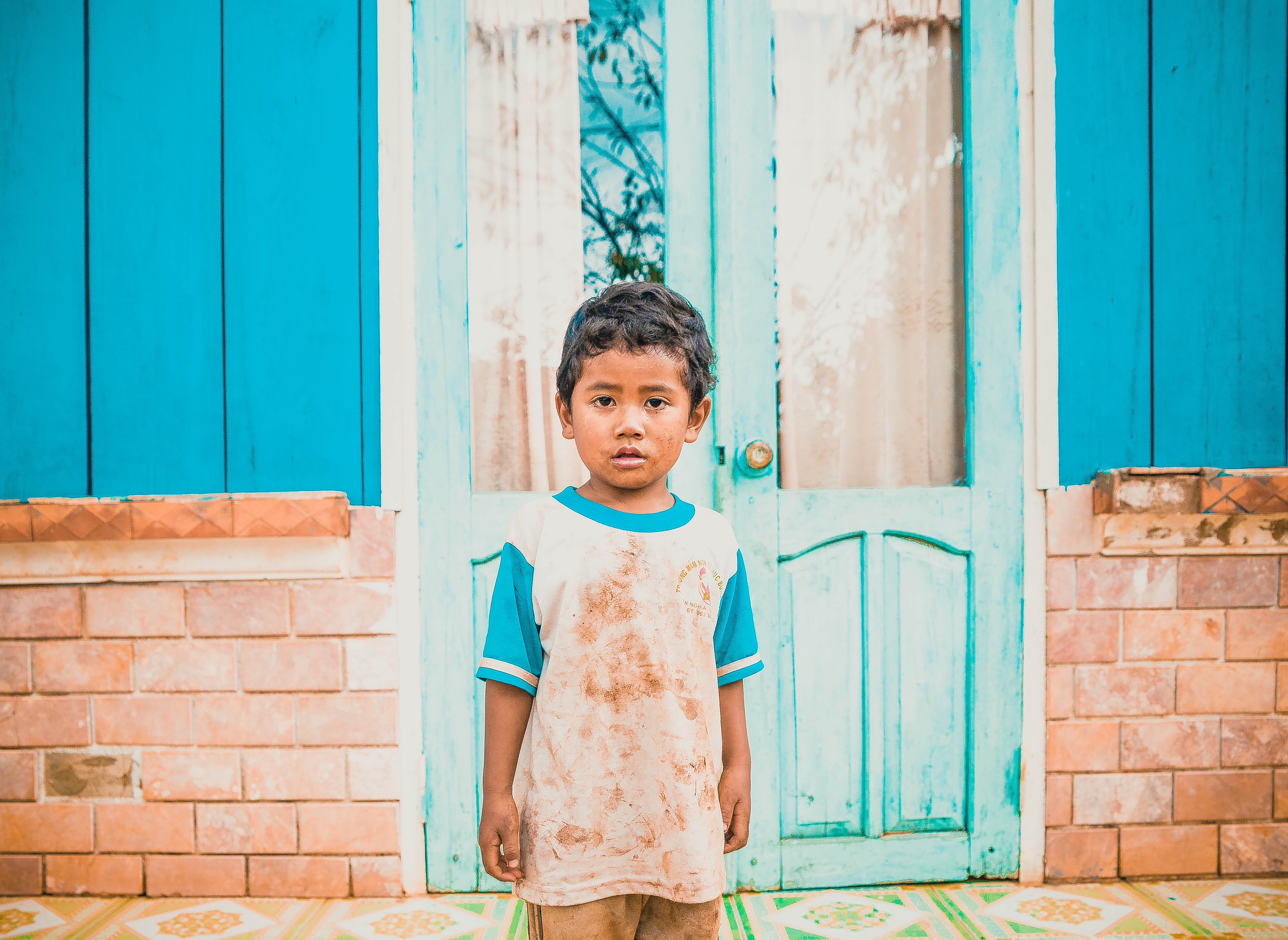 local vietnamese boy staring at the camera in one of the villages in Vietnam not far from Dalat portrait portraiture