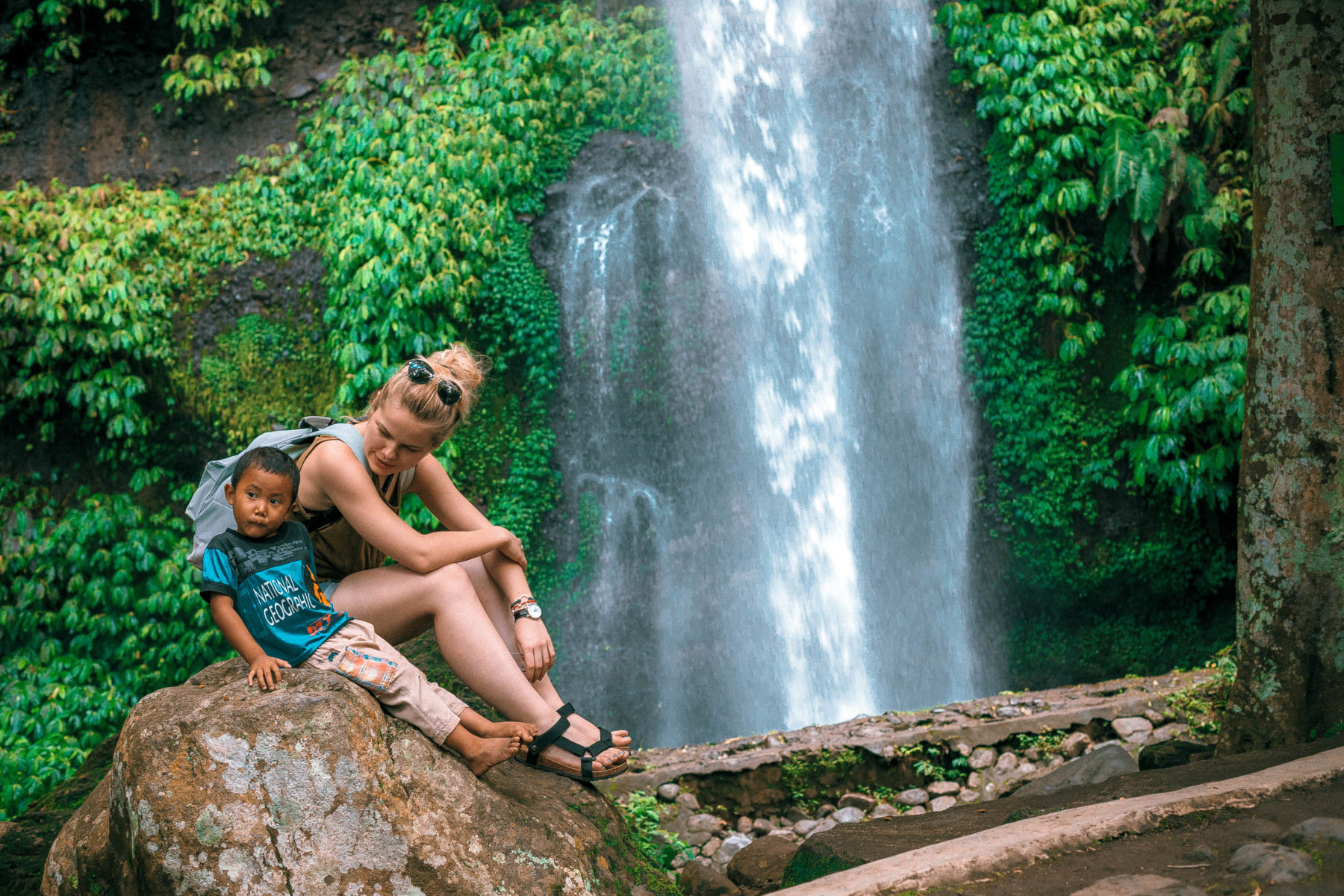 lombok indonesia waterfall green lush jungle exploring traveling local kids